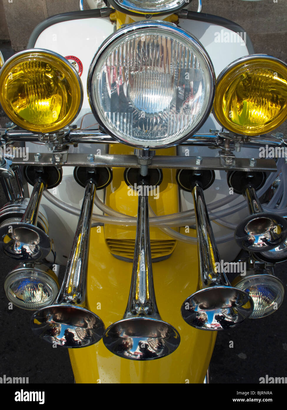 Customised scooter from the 1960's, Mod's Lambretta with lamps, mirrrs and badges - Stock Image