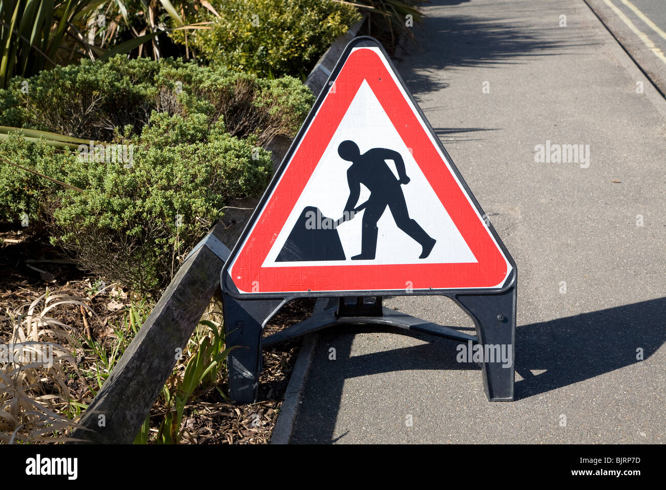 Man at work red triangular road sign - Stock Image