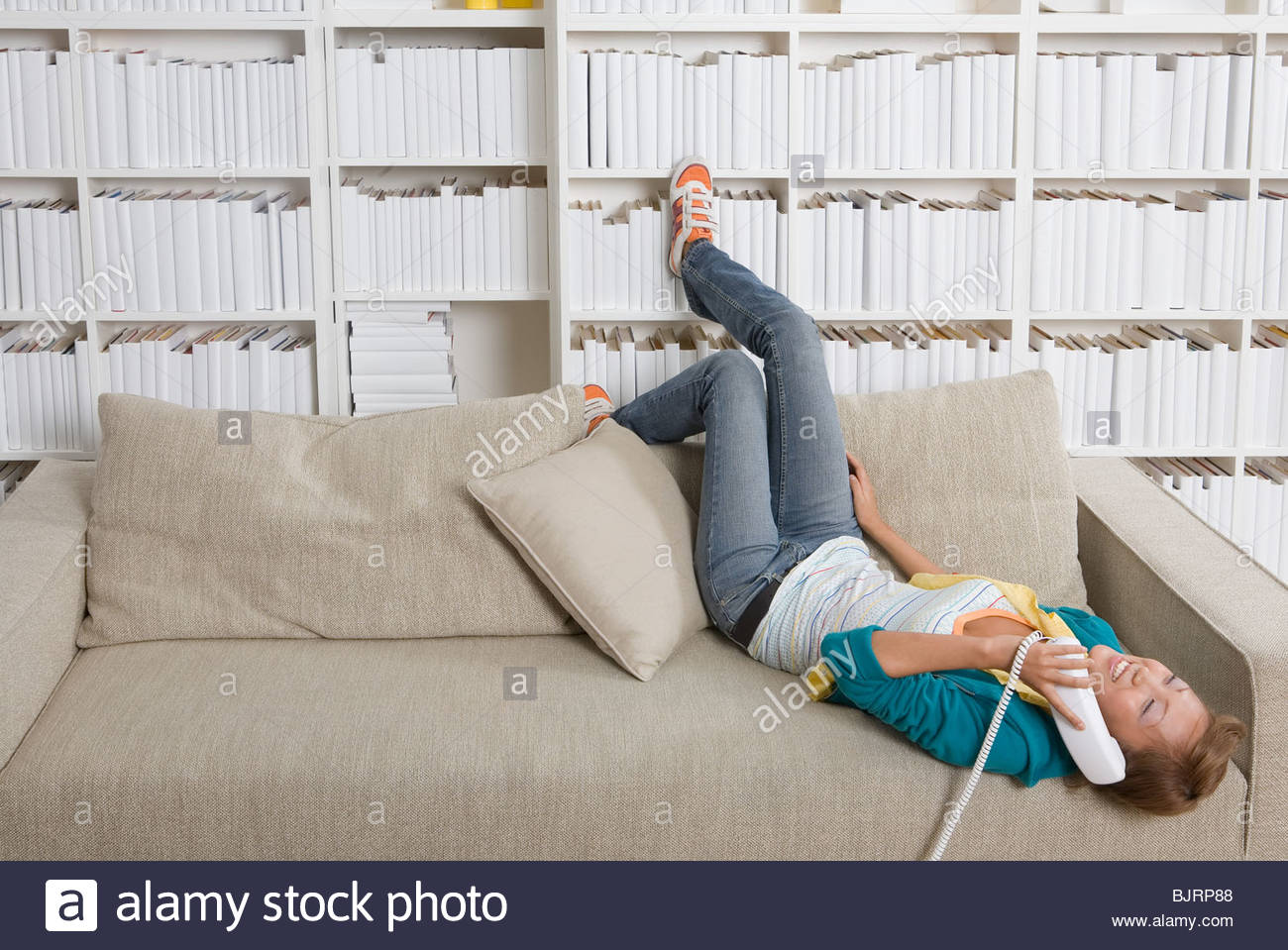 A teenage girl using the telephone - Stock Image