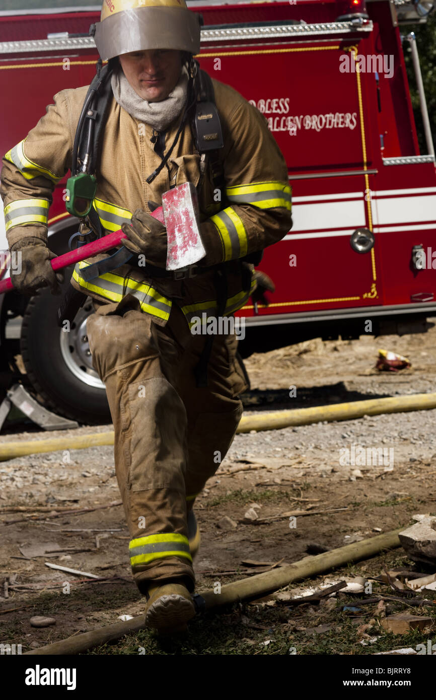 Male firefighter in action - Stock Image