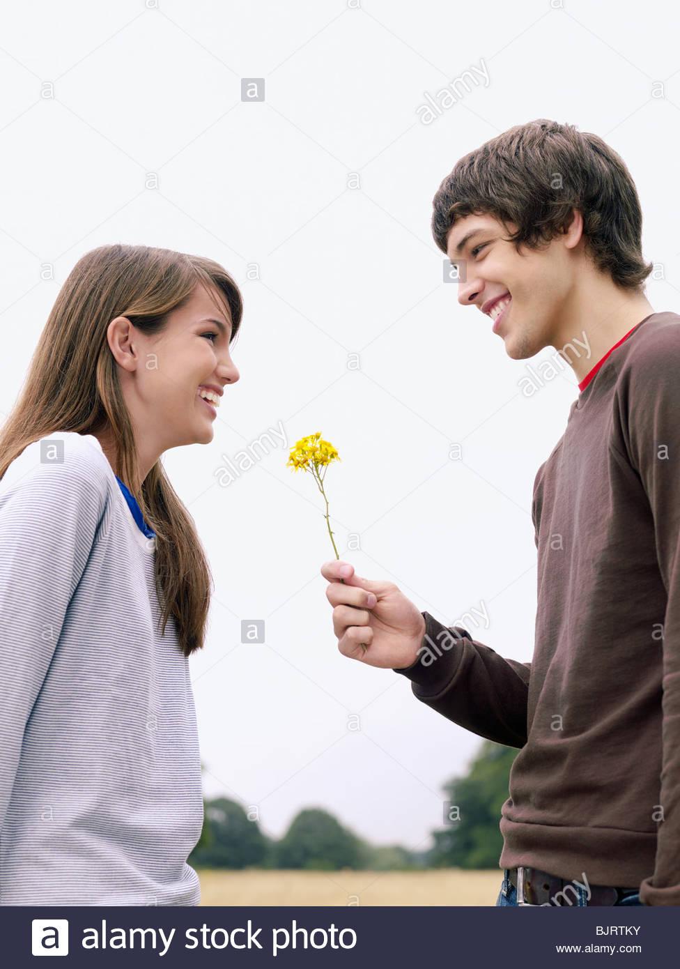 boy giving girl a flower stock photo 28798447 alamy