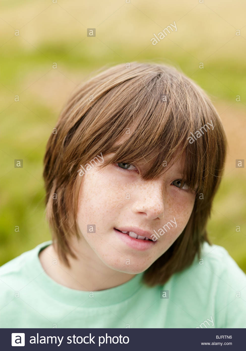 Portrait of a long haired boy - Stock Image