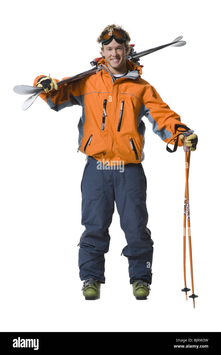 Male skier in orange ski jacket Stock Photo