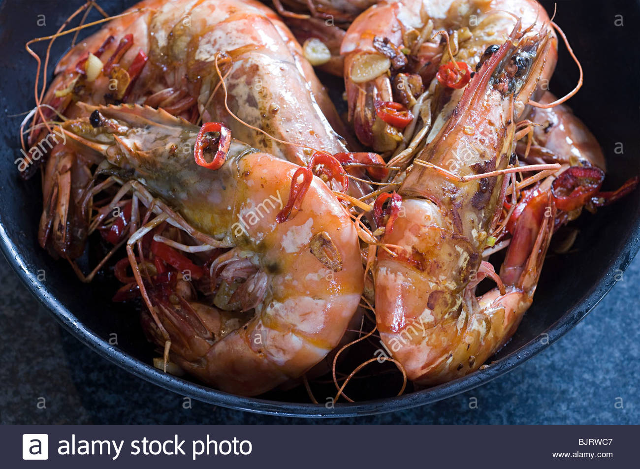 Tiger prawns with chilli - Stock Image