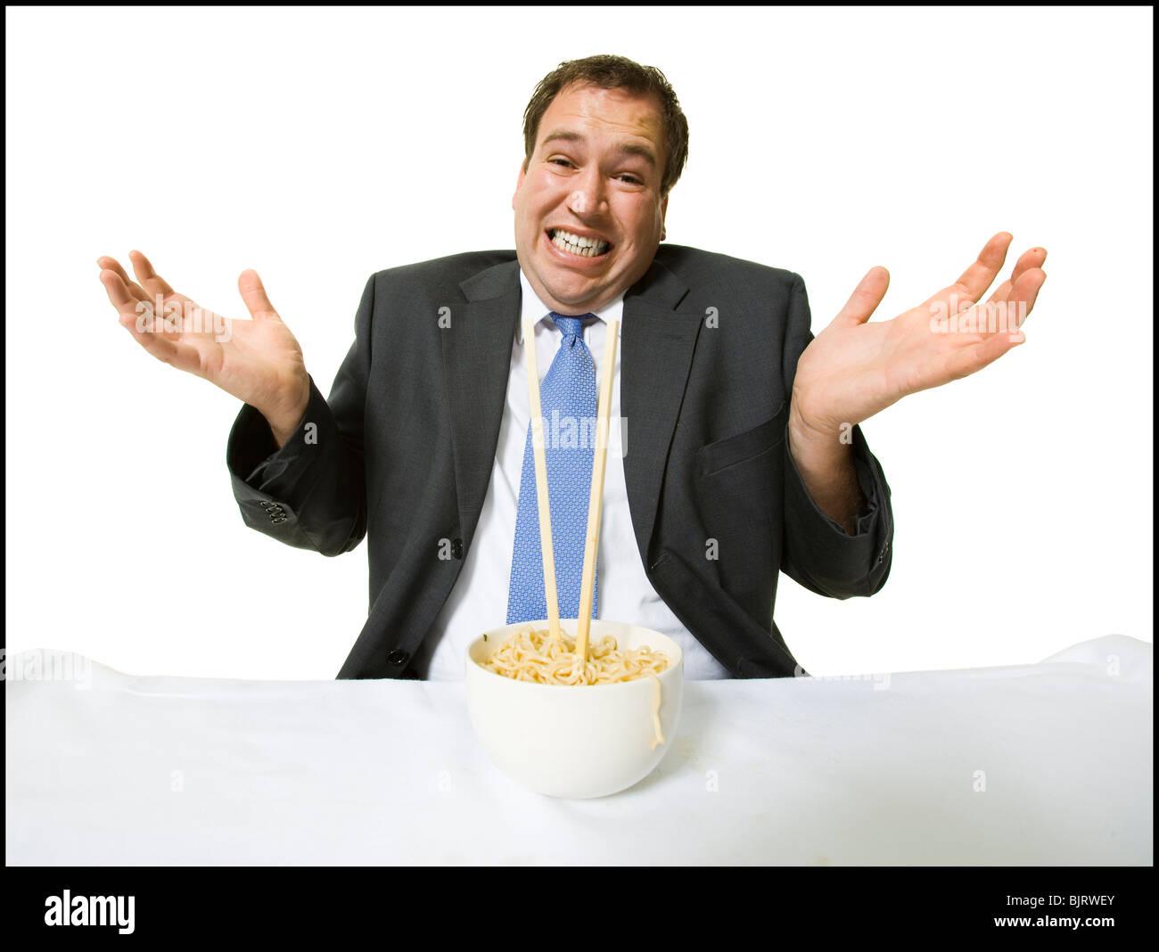 Businessmen eating noodles Stock Photo