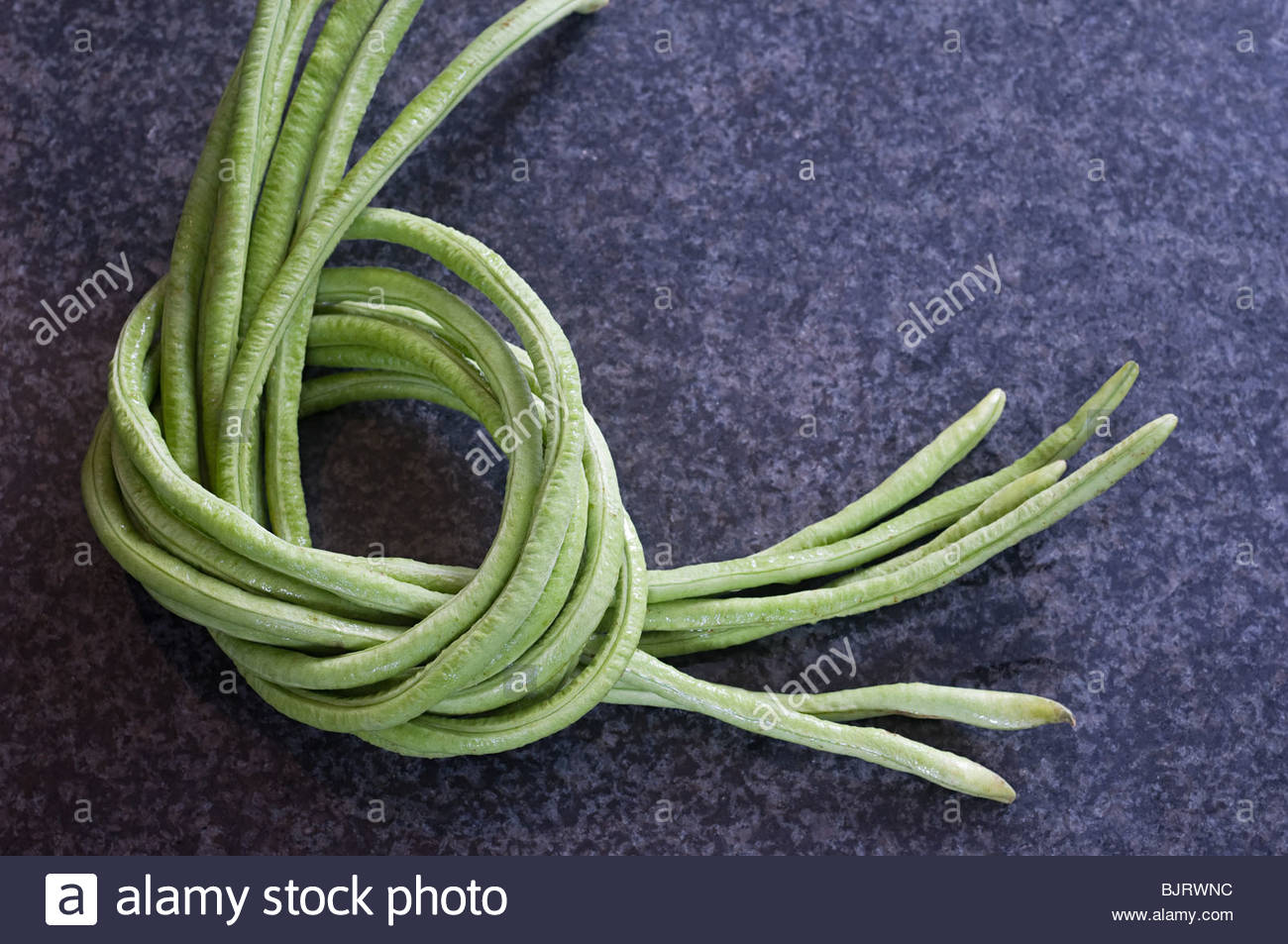 Beans tied together - Stock Image