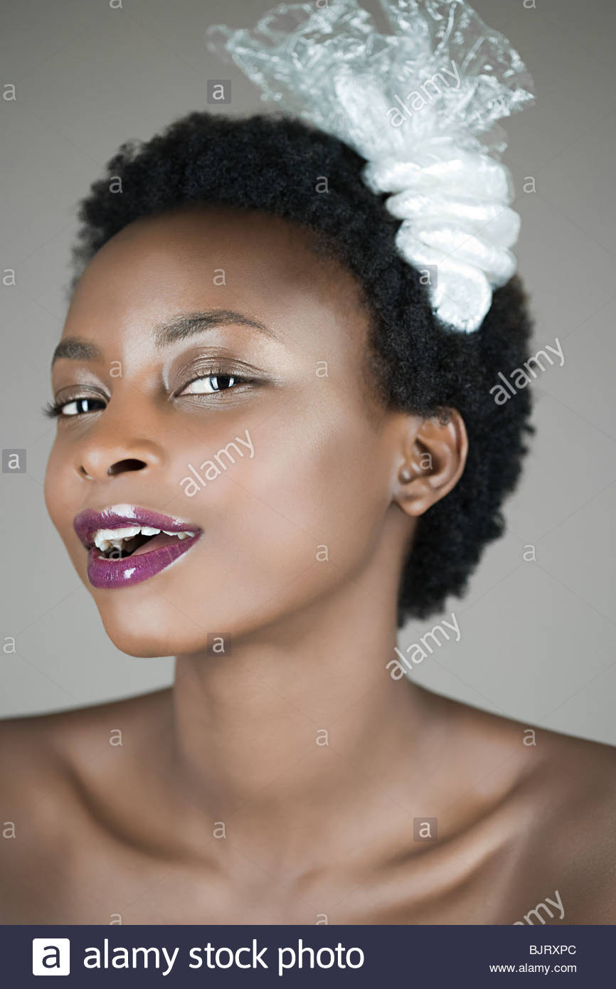 Portrait of a woman wearing a plastic accessory - Stock Image
