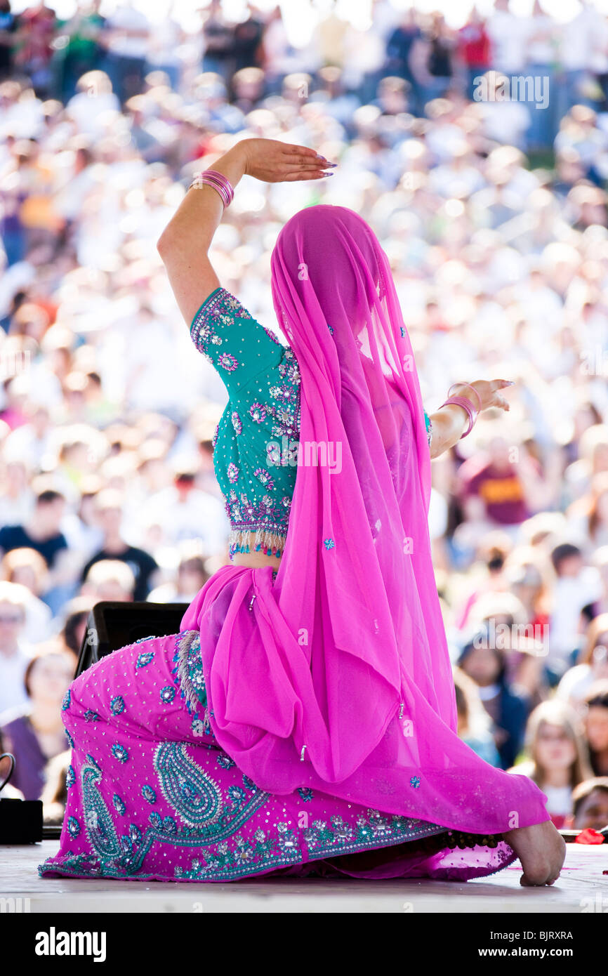 USA, Utah, Spanish Fork, rear view of mid adult dancer in traditional clothing performing on stage - Stock Image