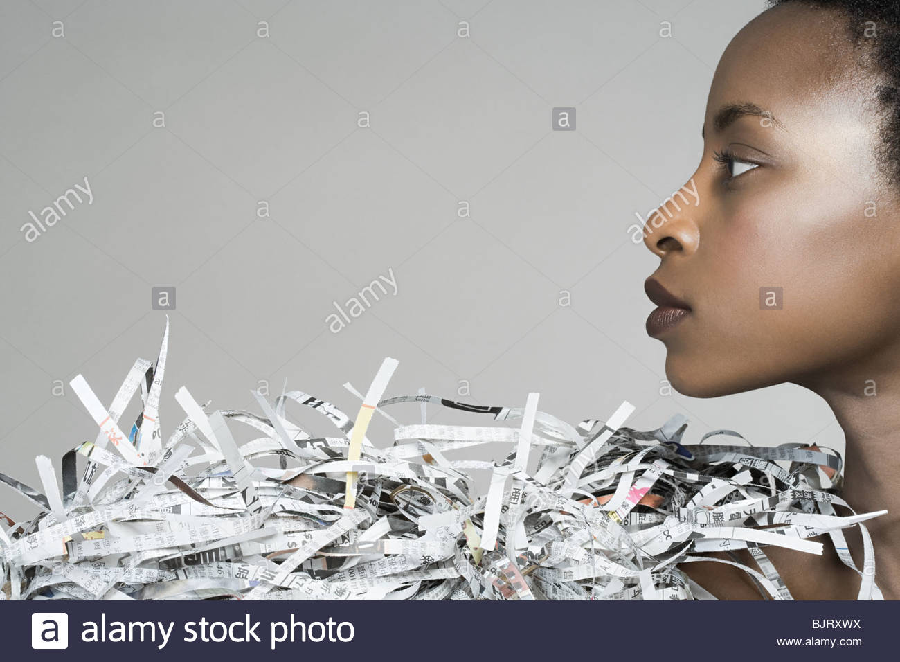 Portrait of a woman wearing newspaper accessory - Stock Image