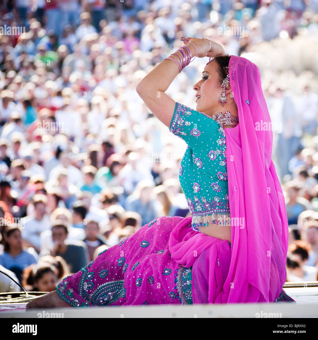 USA, Utah, Spanish Fork, mid adult dancer in traditional clothing performing on stage - Stock Image