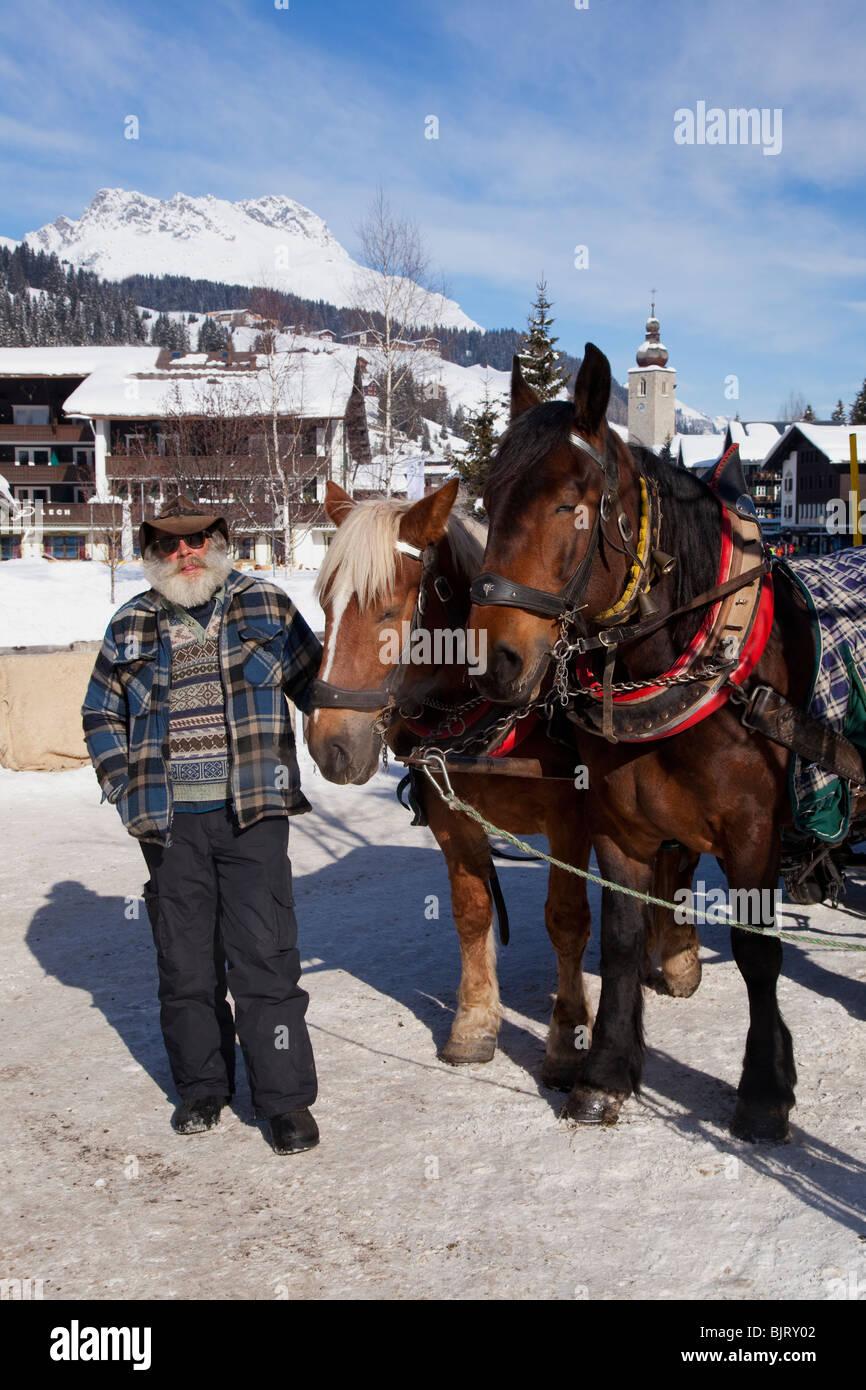 Horses and sleigh Lech near St Saint Anton am Arlberg in winter snow Austrian Alps Austria Europe - Stock Image