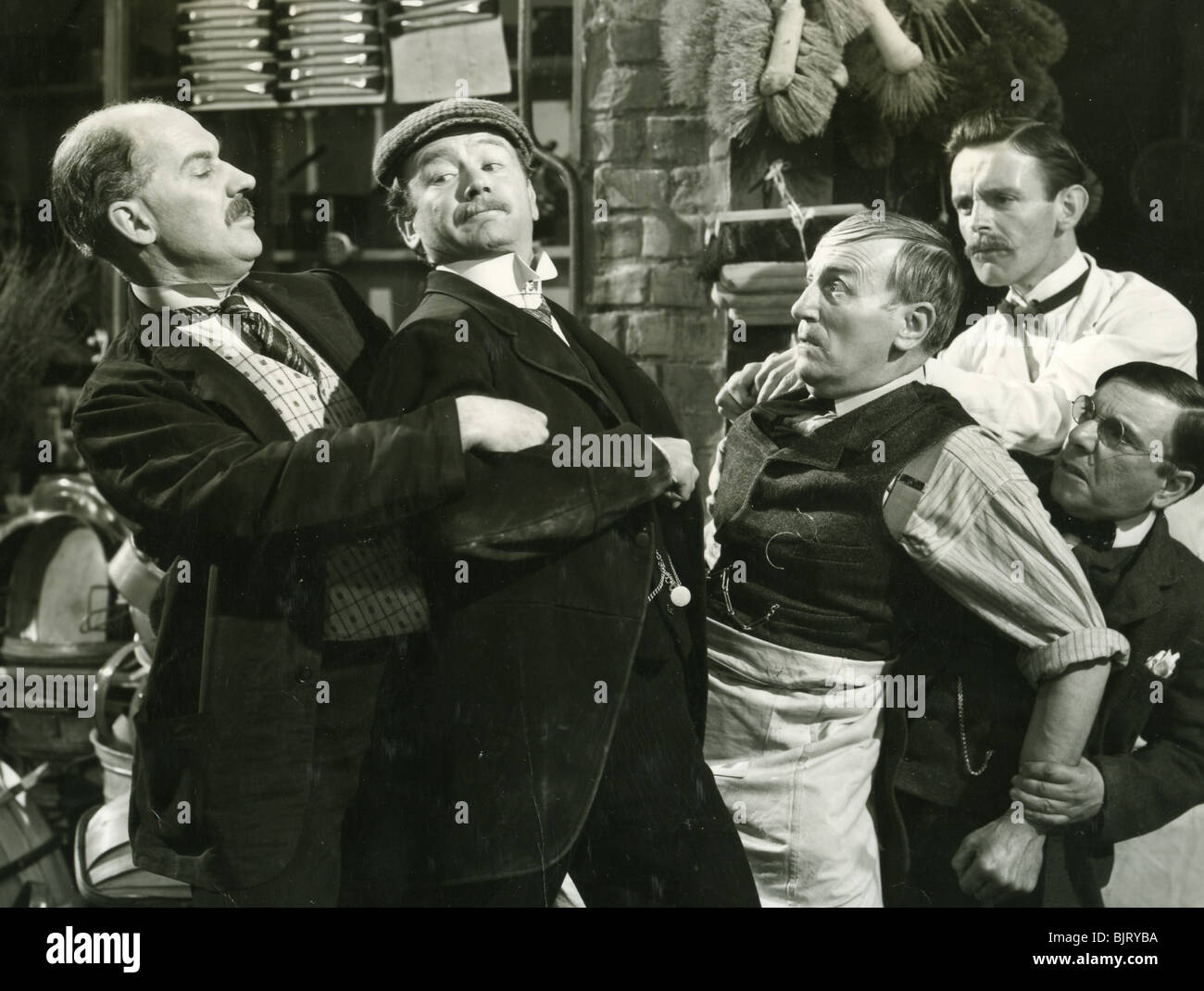 THE HISTORY OF MR POLLY - 1948 GFD film with John Mills in cap - Stock Image