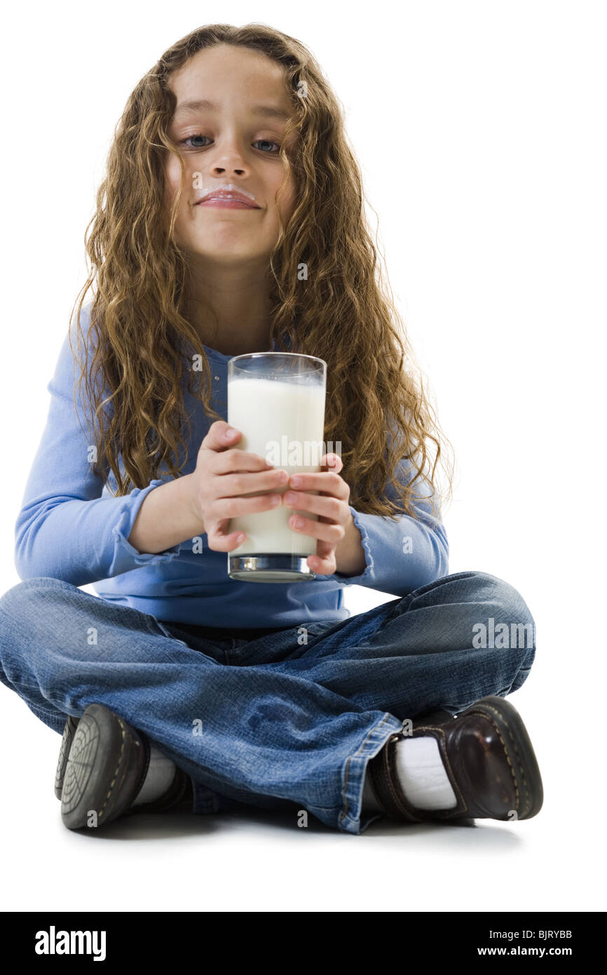 Young girl with a glass of milk - Stock Image