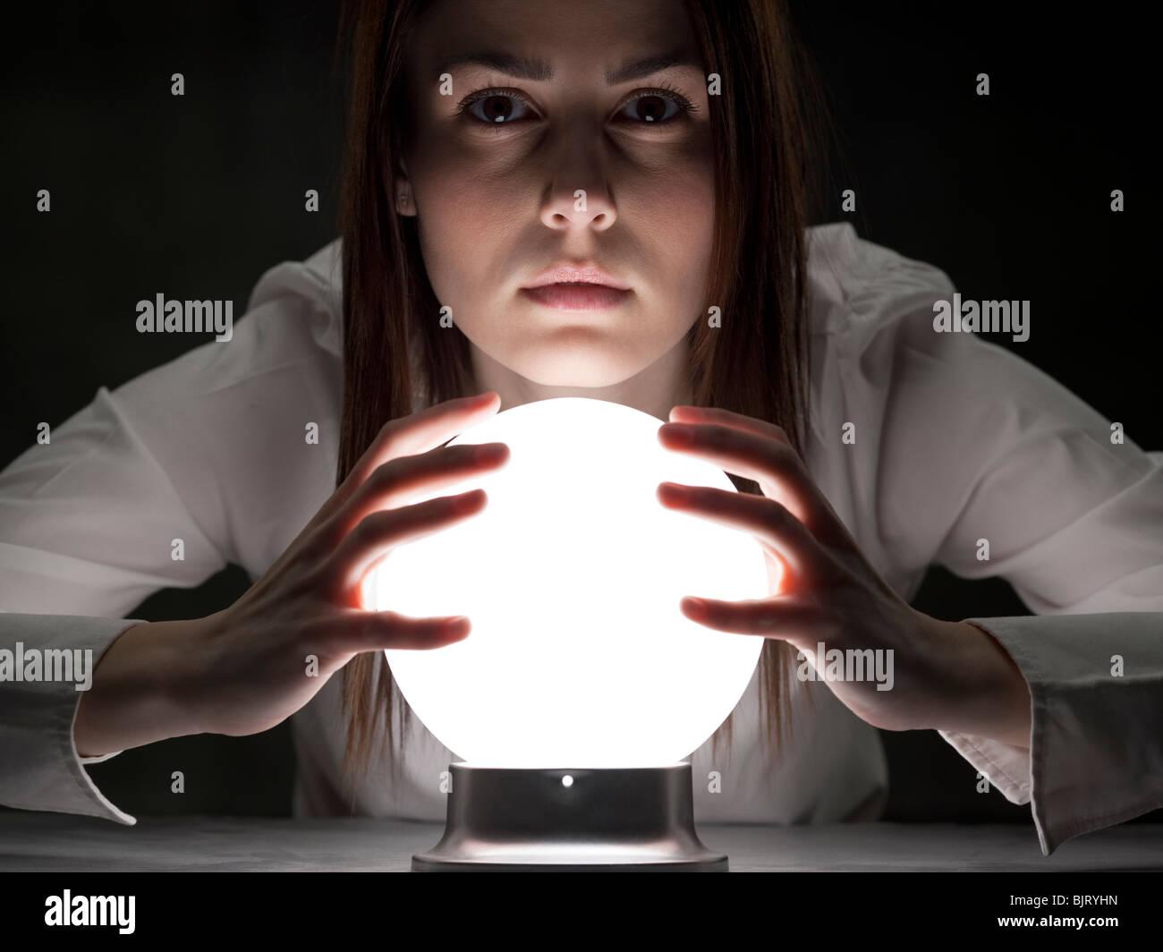 Fortune teller holding crystal ball, portrait - Stock Image