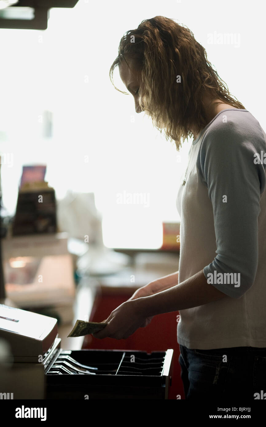 Female clerk in retail store - Stock Image