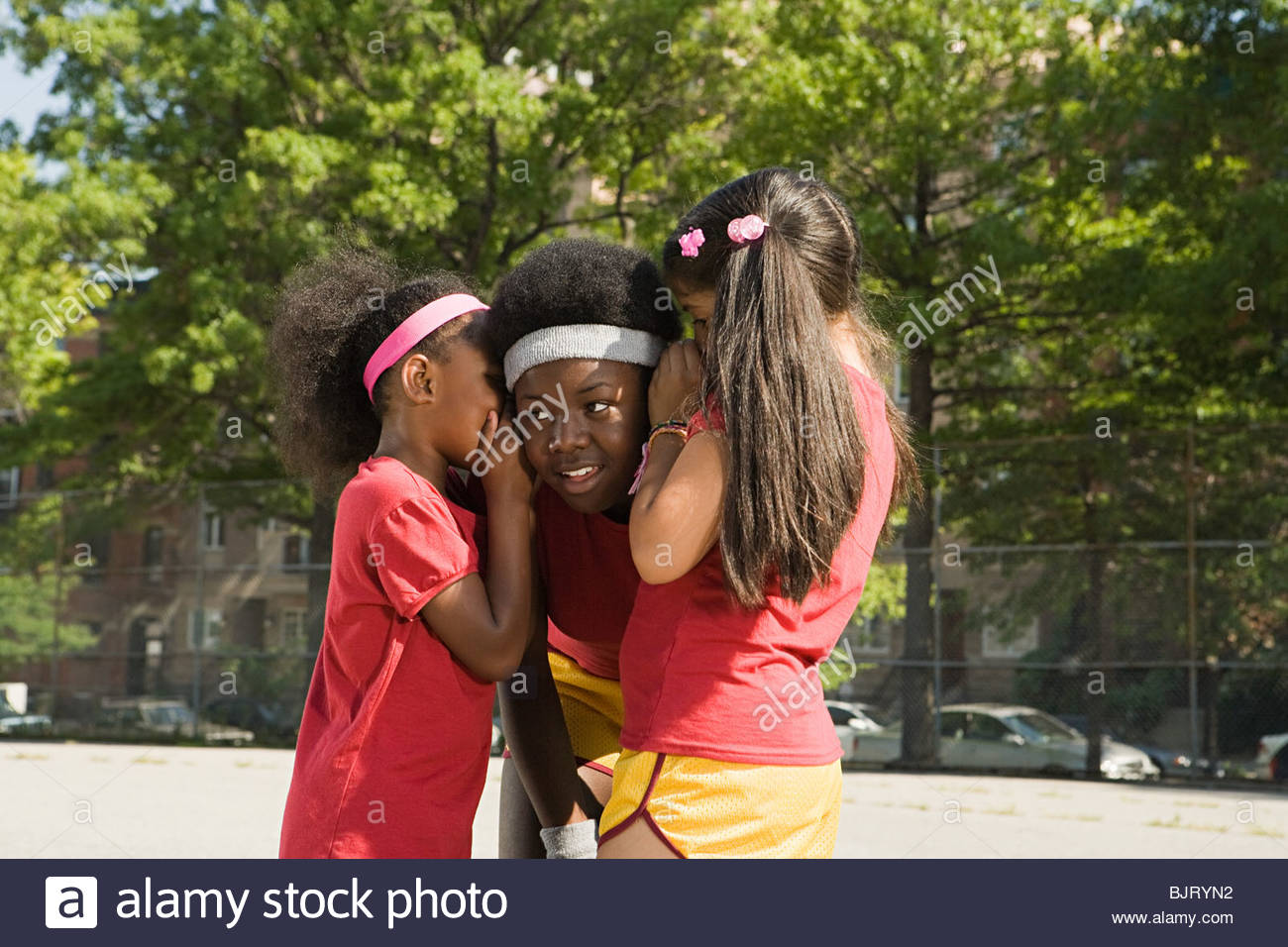 Girls whispering - Stock Image