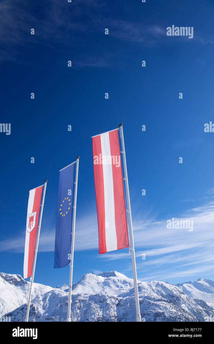 Austrian European Union flags and mountains Lech near St Saint Anton am Arlberg in winter snow Austrian Alps Austria - Stock Image