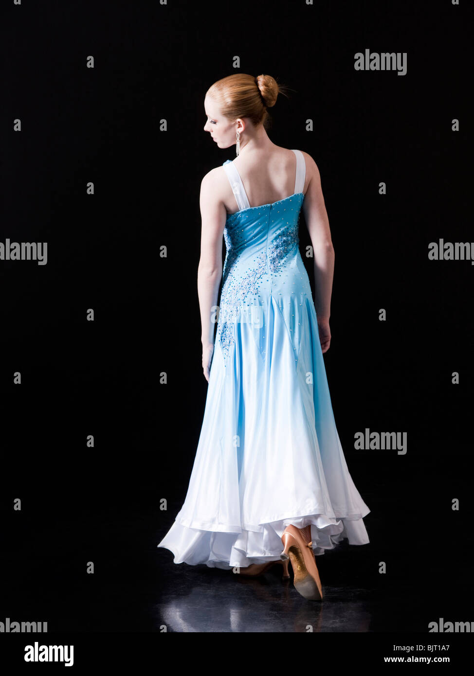 Young woman posing as professional dancer, studio shot Stock Photo