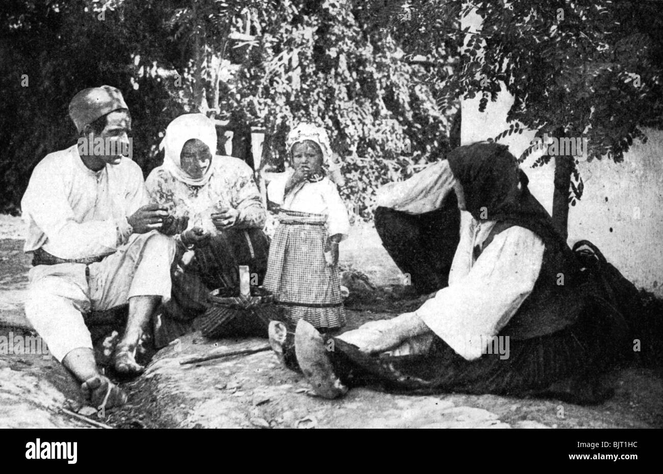 Serbian family telling the story of routing the Austrians from Bosnia, First World War, 1914. - Stock Image