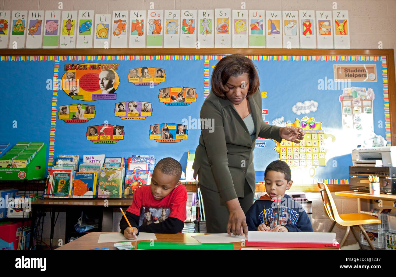 Detroit, Michigan - First grade teacher Ivy Bailey at MacDowell Elementary School. - Stock Image
