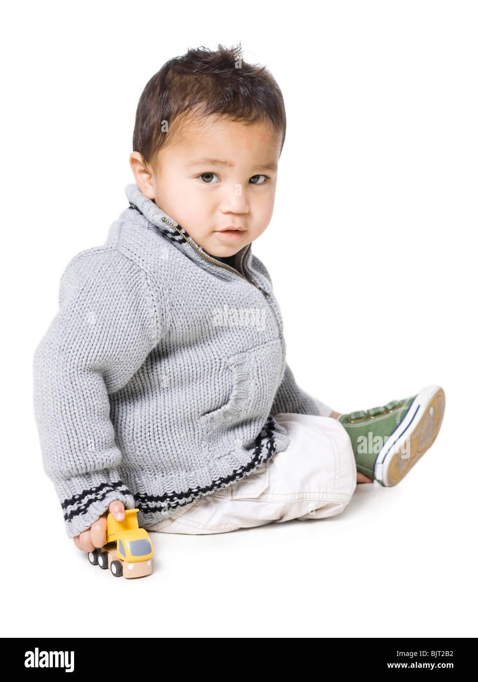 Studio portrait of boy (18-23 months) - Stock Image