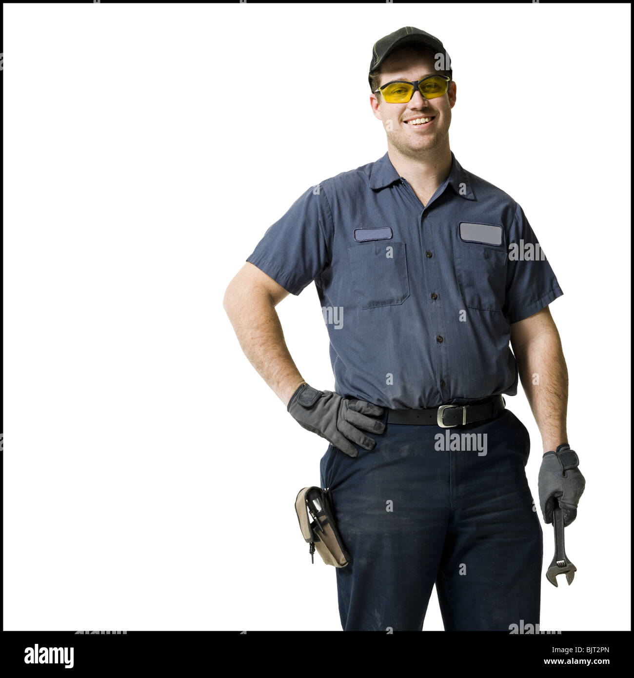 Repairman holding a wrench Stock Photo