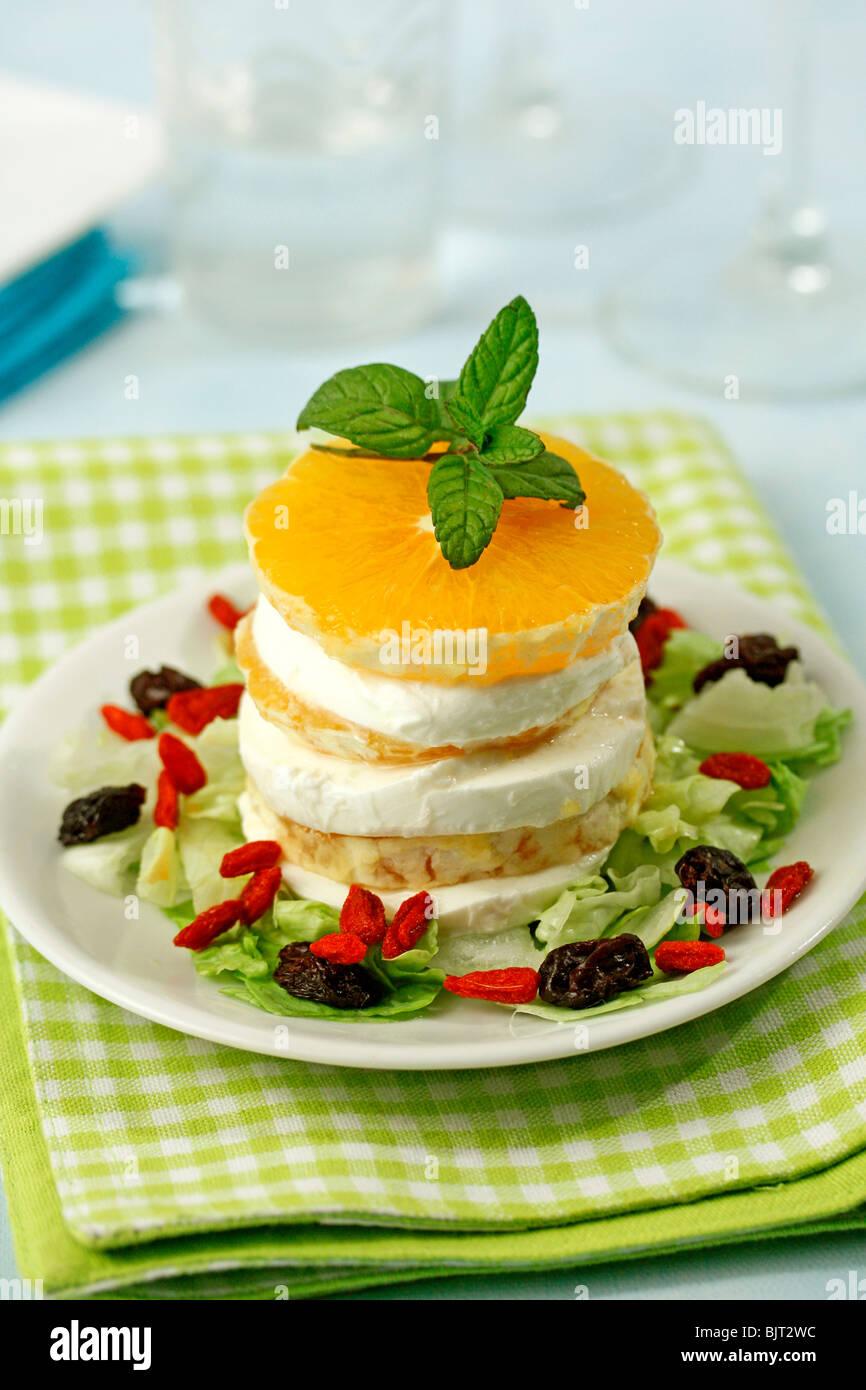 Orange and mozzarella tower. Recipe available. - Stock Image