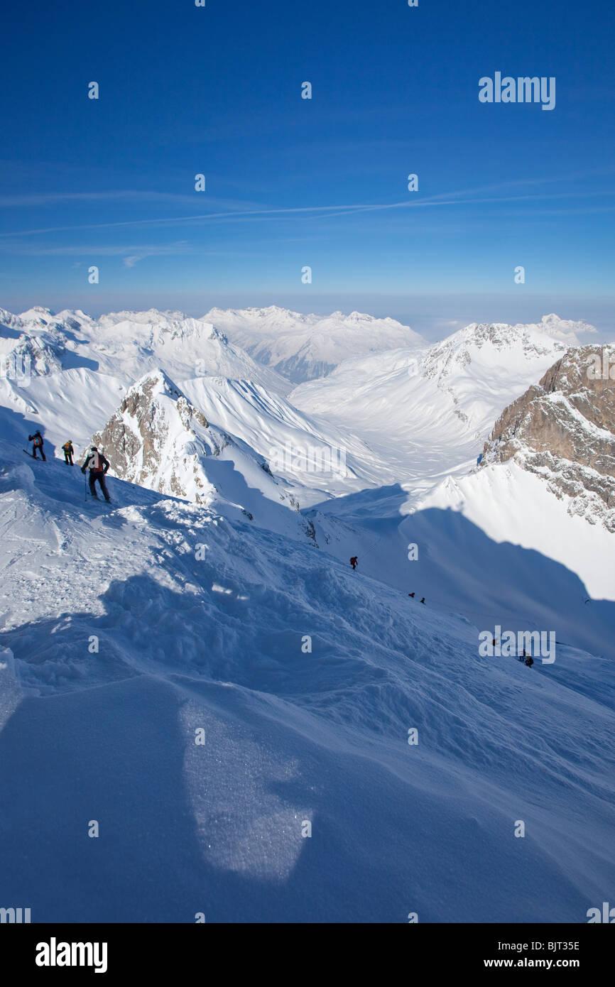 Skiing off-piste from summit of Valluga St Saint Anton am Arlberg in winter snow Austrian Alps Austria Europe - Stock Image