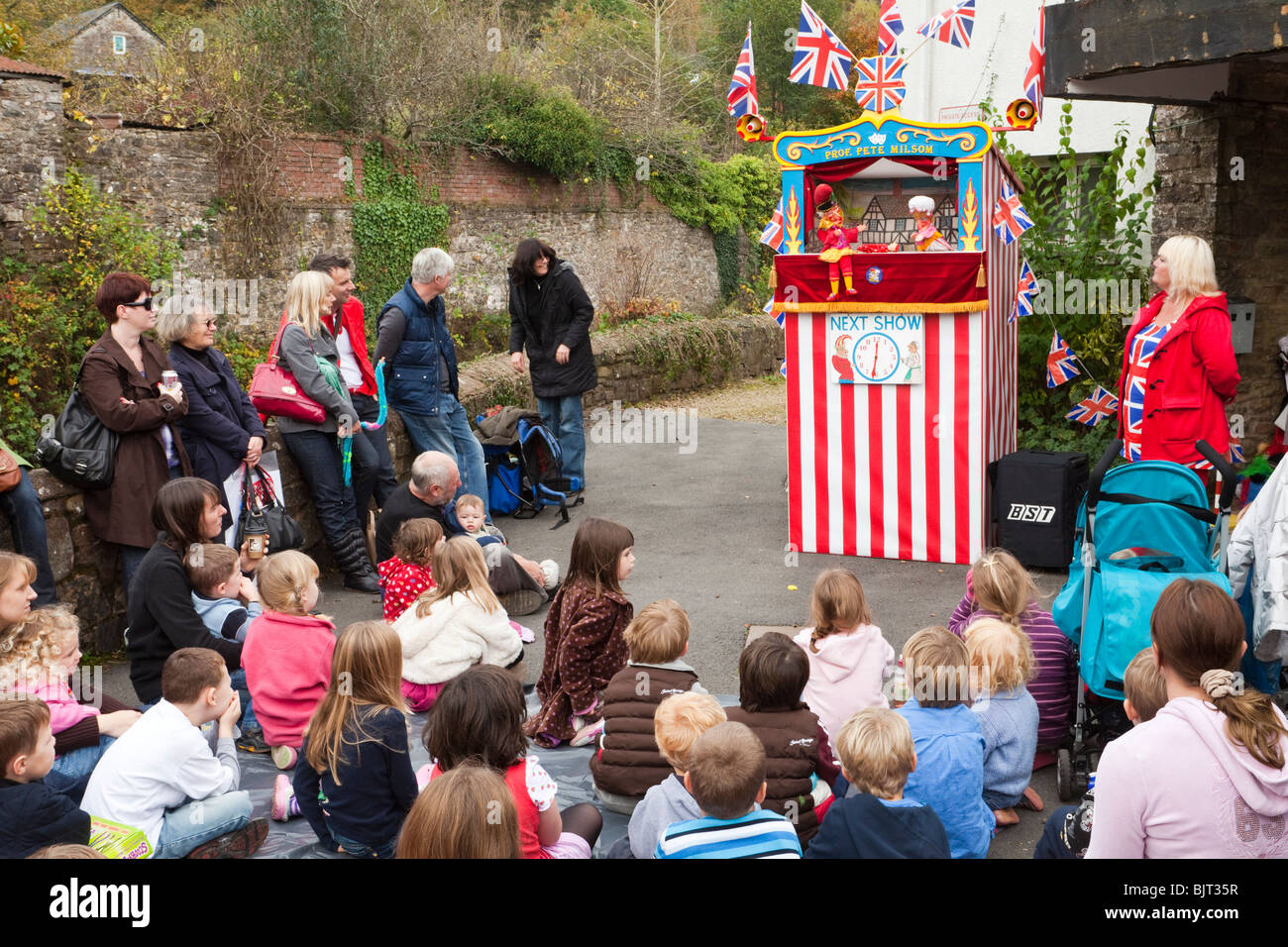 A traditional Punch and Judy show being performed at the Bampton Charter Fair, held every October in Bampton, Devon - Stock Image