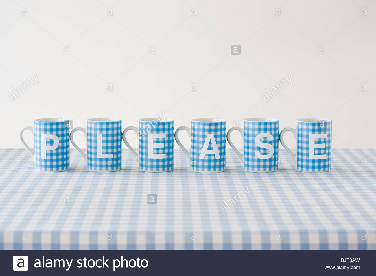 Please written on cups - Stock Image