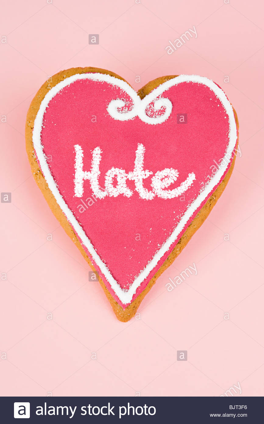 Hate written on heart shaped candy Stock Photo