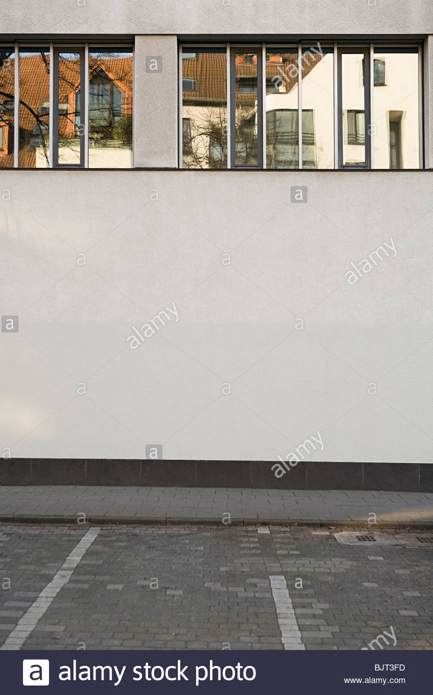 Houses reflected in window - Stock Image