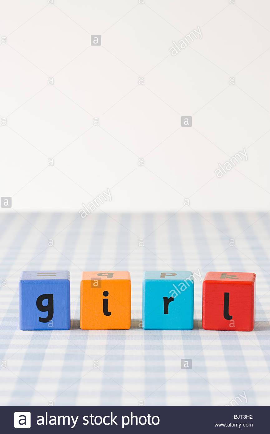 Girl written on building blocks - Stock Image