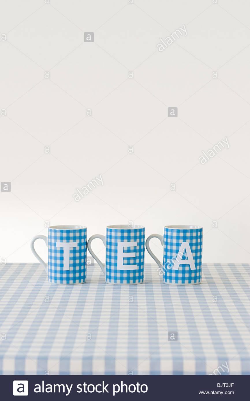 Tea written on cups Stock Photo