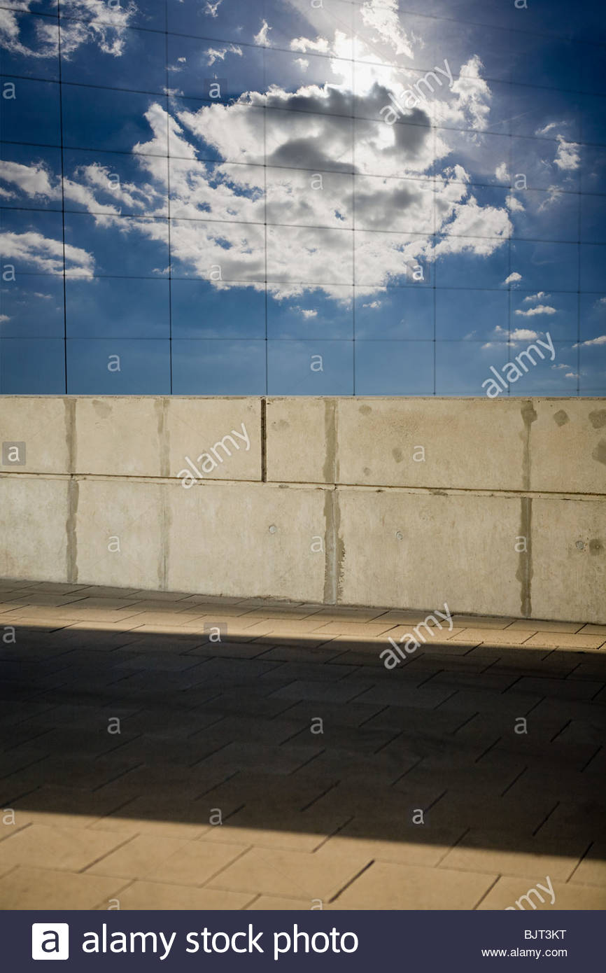 Sun and cloud reflected in a window - Stock Image
