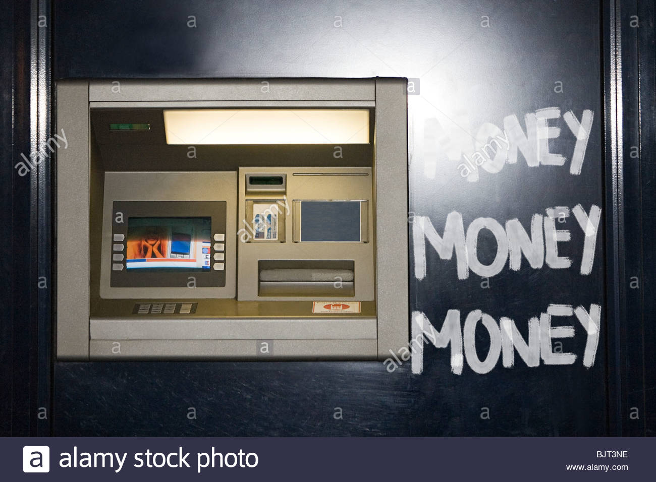 Money written next to an atm - Stock Image