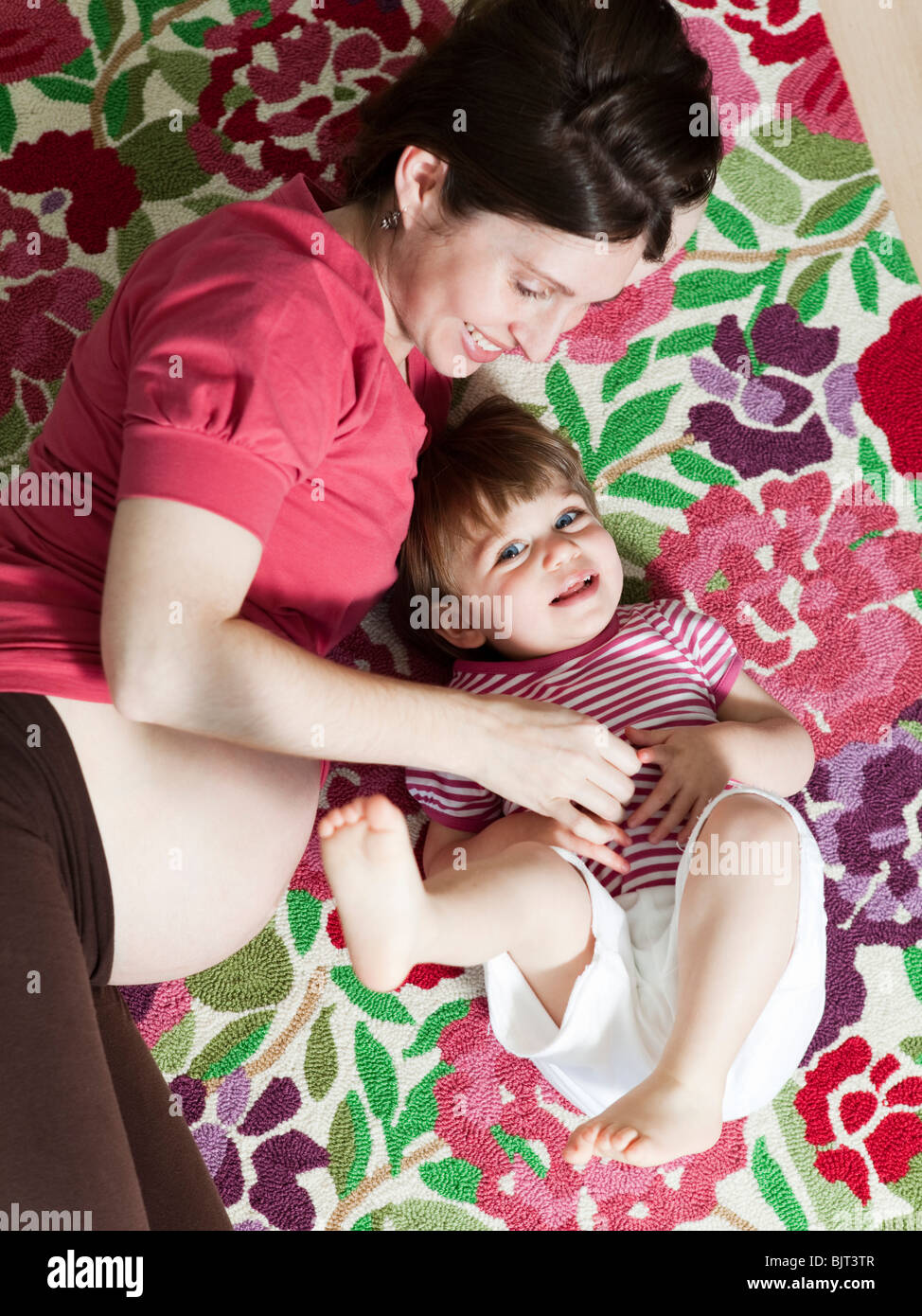 USA, California, San Francisco, mid adult pregnant mother with daughter (2-3) - Stock Image