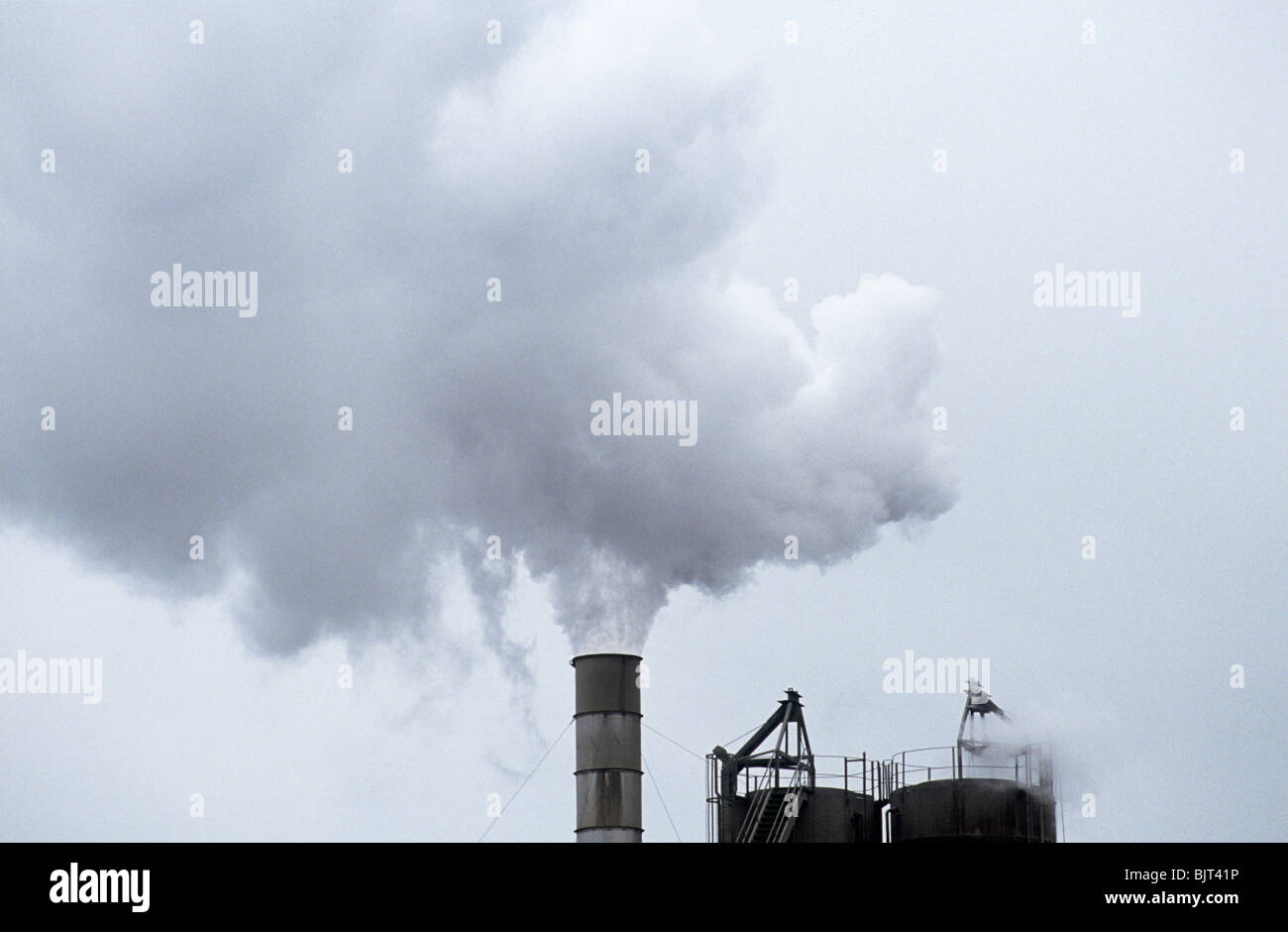 Smoke coming out of a chimney - Stock Image