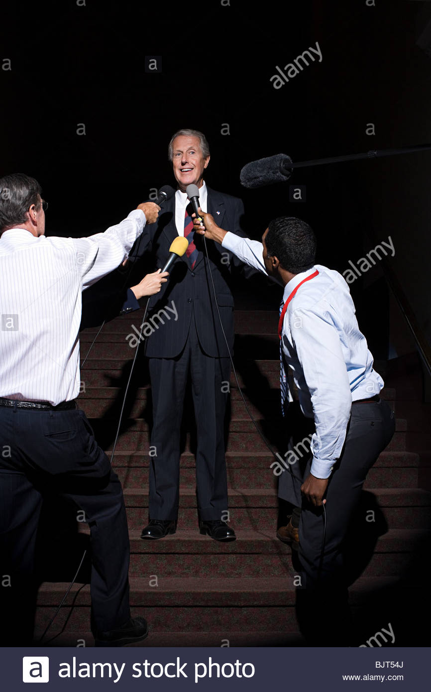 A politician being interviewed by reporters Stock Photo