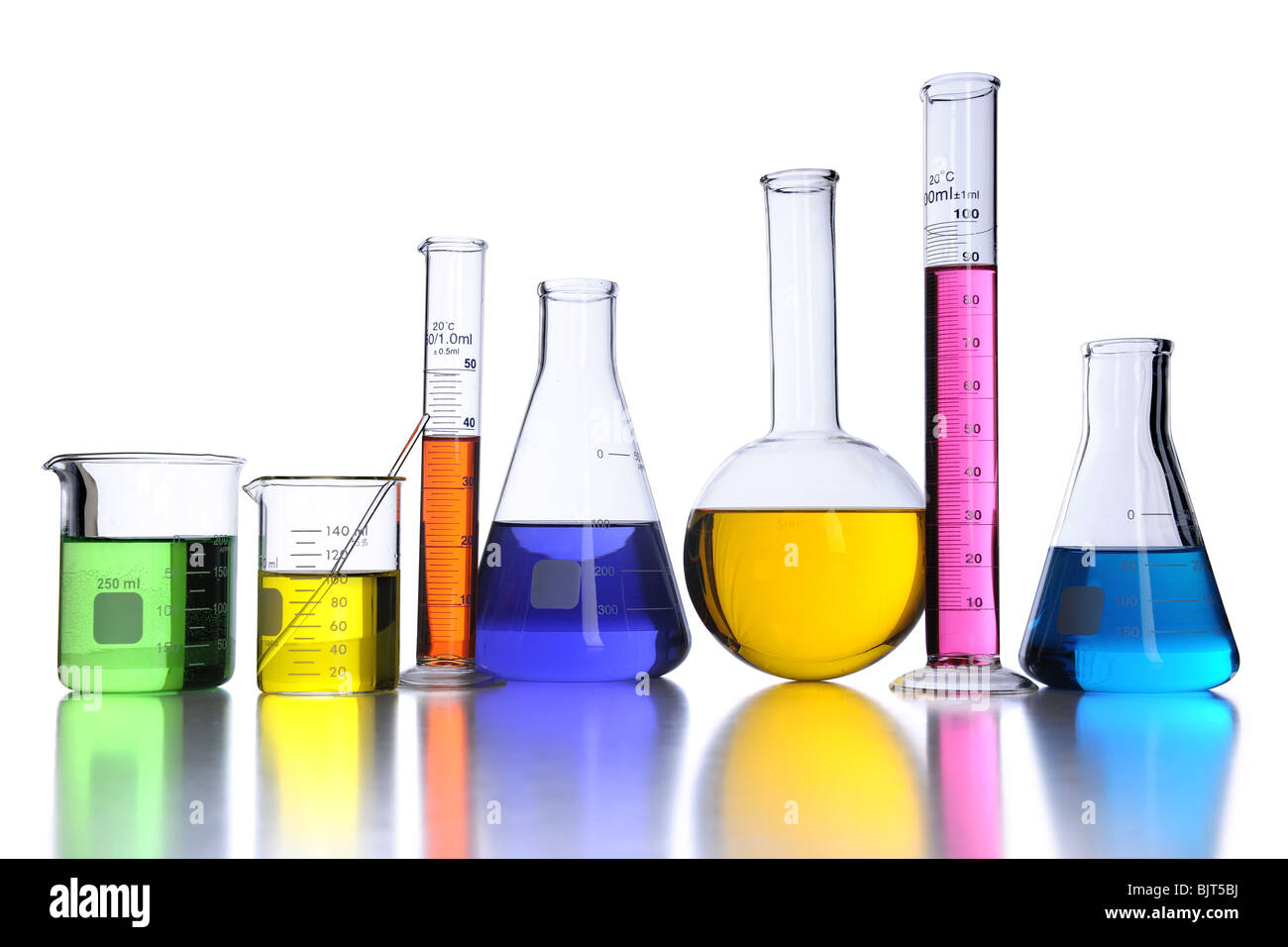 Laboratory glassware with color fluids over white background - Stock Image