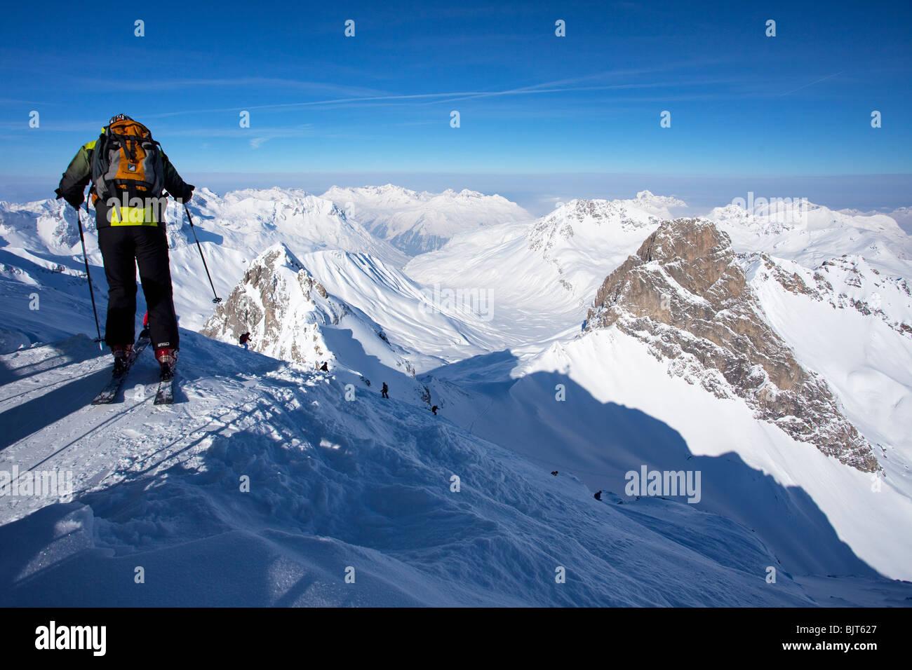 Skiing off-piste from summit of Valluga in St Saint Anton am Arlberg in winter snow Austrian Alps Austria Europe - Stock Image