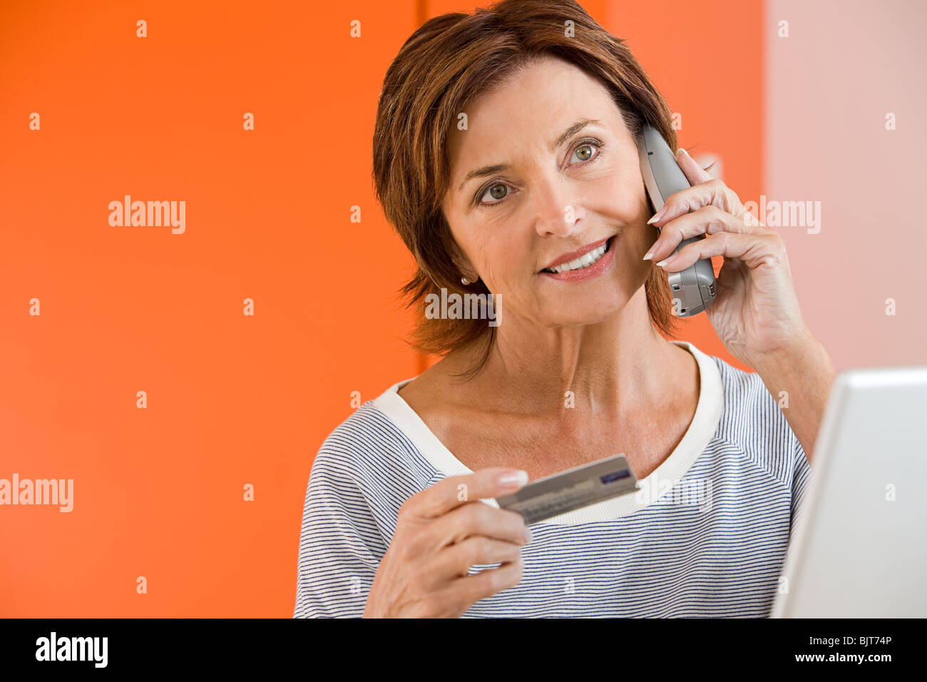 A woman telephone banking - Stock Image