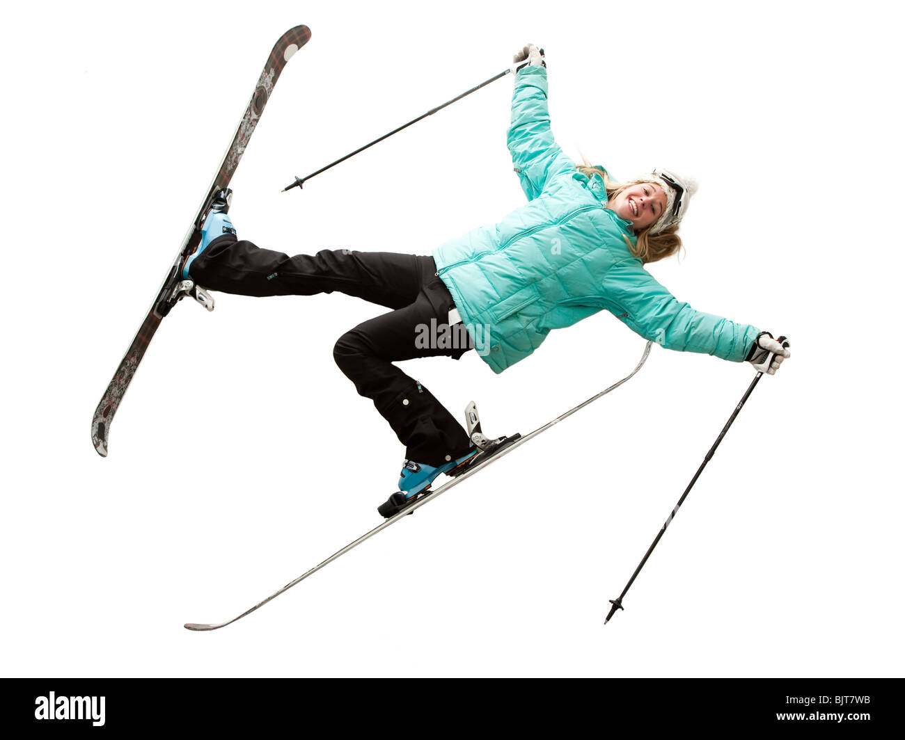 Portrait of young woman in skiwear, Lying down - Stock Image