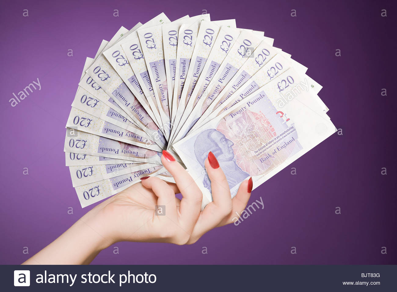 Hand fan of banknotes - Stock Image