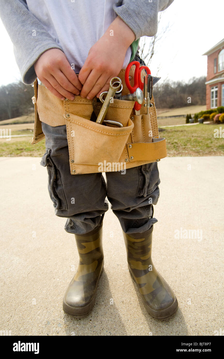 Little boy with tools - Stock Image
