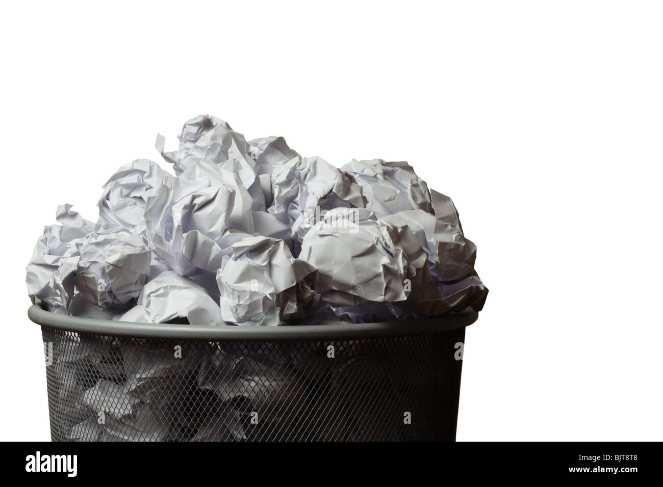Waste bin full of screwed up pieces of paper. Cutout on a white background with space for copy. - Stock Image