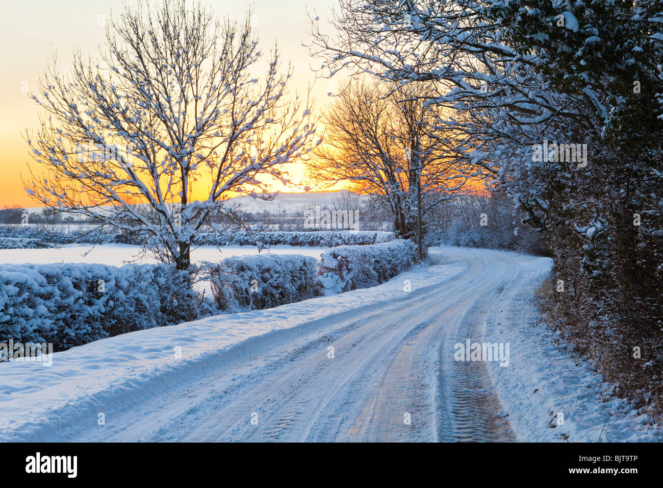 A winter sunset from the Cotswold lane between Stanton & Stanway, Gloucestershire UK Stock Photo