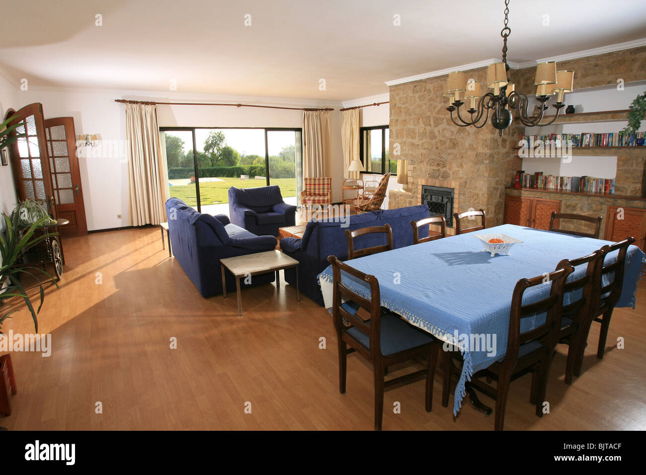 Holiday Vacation Villa Lounge And Dining Room Interior With Furniture Sliding Doors Leading To The Garden Swimming Pool