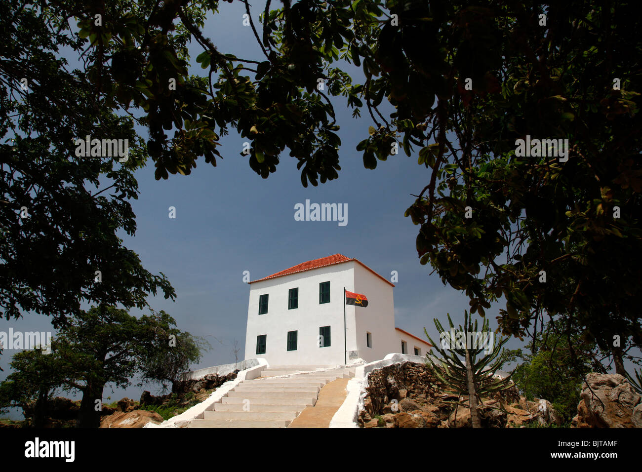 The white painted chapel of the Slave museum stands opposite the island of Mussulo. Luanda, Angola. Africa. © - Stock Image