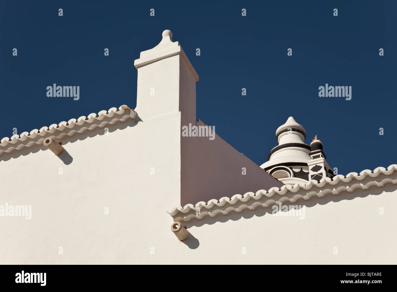 A house roof tower against a blue sky in the city of Lagos - Stock Image